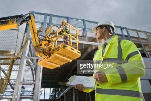 Construction workers with crane : Stock Photo