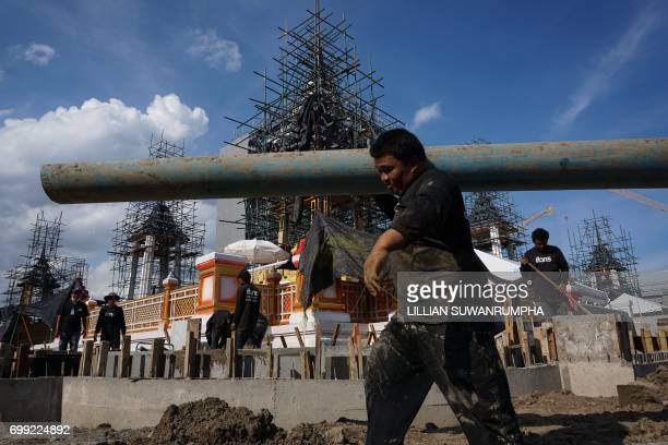 Construction workers work around the funeral pyre and surrounding pavilions for the late Thai King Bhumibol Adulyadej inside Sanam Luang park in...