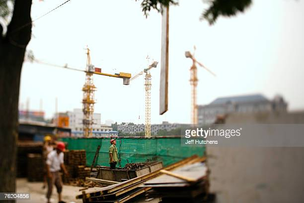 Construction workers work on a project on June 30 2006 in Beijing China China continues to open both socially and economically with the 2008 Summer...