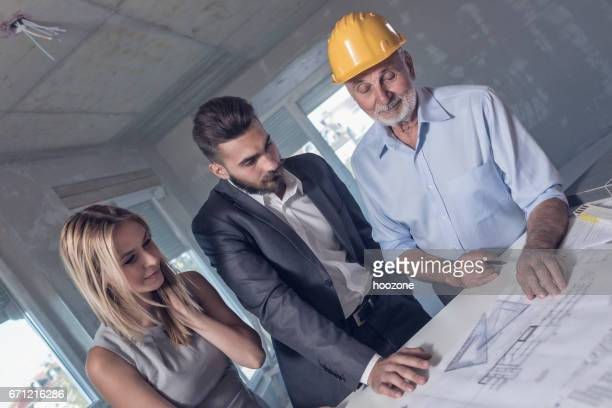 Constructor, Architect and Investor on a Meeting