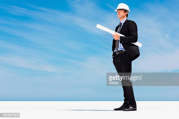 Constructor in hardhat with blueprints against blue sky