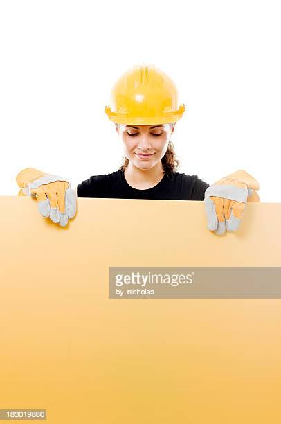Constructor woman with empty board, isolated on white