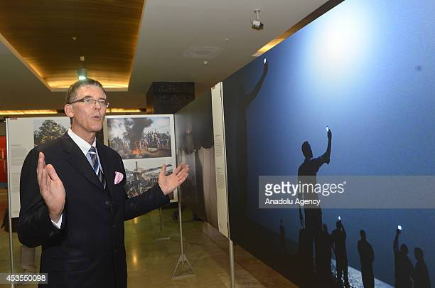 Consul General of the Kingdom of the Netherlands Robert Schuddeboom attends the World Press Photo 2014 exhibition award winning snapshots by...