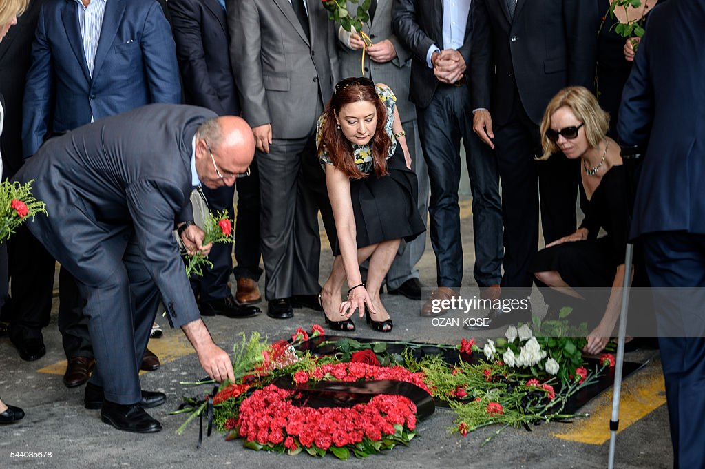 Consuls of European countries lay cloves and roses at the explosion site at Ataturk airport International terminal on July 1, 2016 three days after a suicide bombing and gun attack targeted Istanbul's Ataturk airport, killing 44 people. Although no group has yet claimed Tuesday's gun and bomb attack which killed 42 people, Ankara has pointed a finger at IS, which has been blamed for several suicide attacks around the country in the past year. / AFP / OZAN