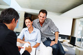 Consultant advising a young couple at home