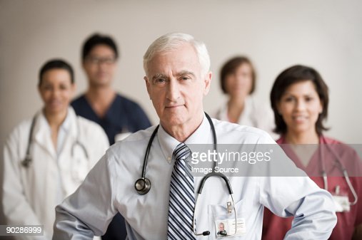 Consultant and colleagues : Stock Photo
