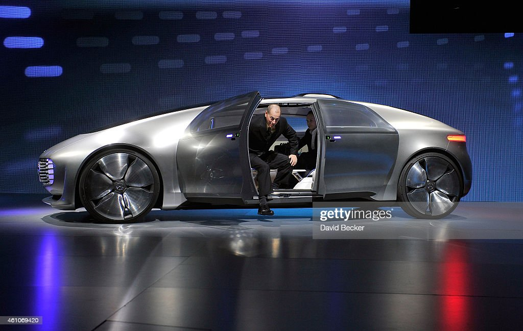 Consumer Electronics Association President and CEO Gary Shapiro exits a MercedesBenz F 015 autonomous driving automobile after it was unveiled at a...