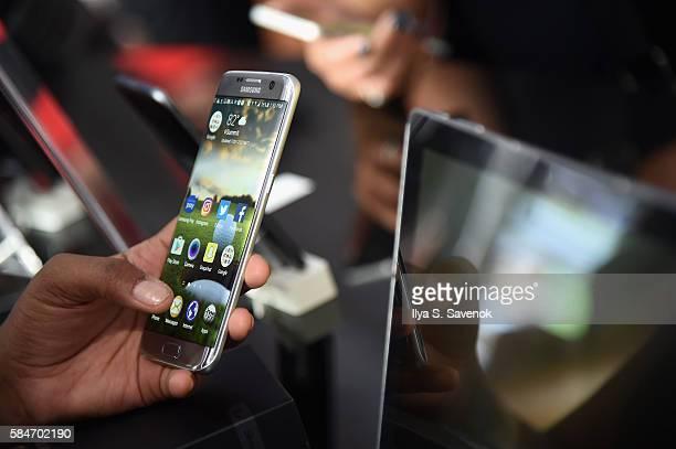 A consumer enjoy the Samsung Galaxy S7 Edge smart phone at The Samsung Experience at the PGA Championship 2016 at Baltusrol Golf Club on July 30 2016...