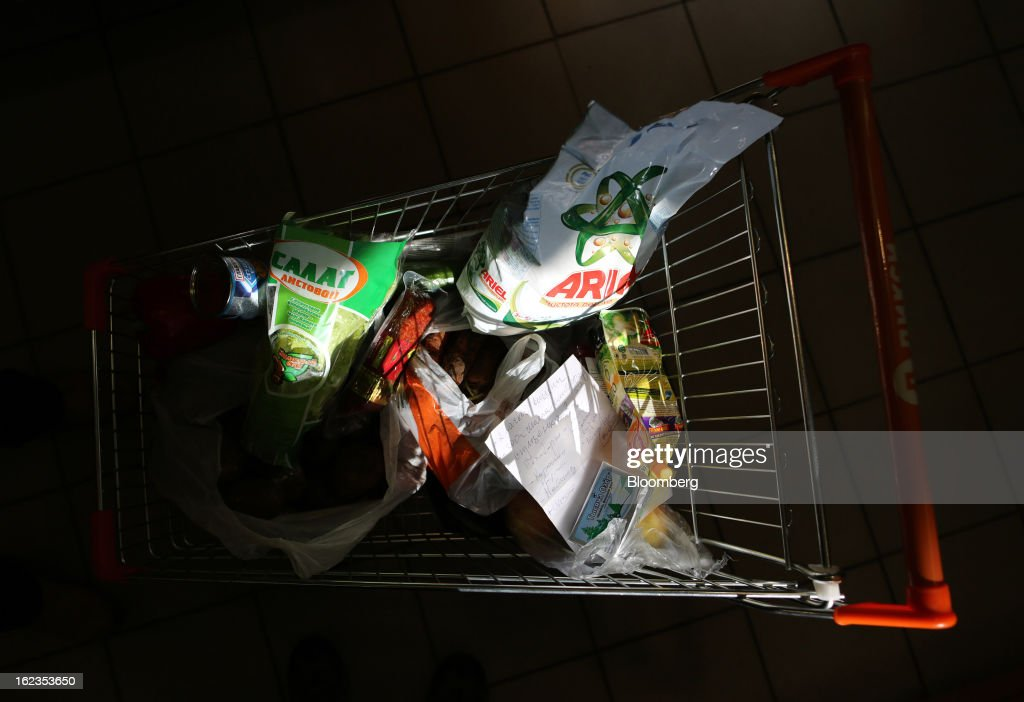 Consumer goods sit in a shopping cart inside a supermarket operated by OAO Dixy Group in Moscow, Russia, on Friday, Feb. 22, 2013. Russia's largest retailer by market value, OAO Magnit, is spending as much as $1.8 billion this year to compete against X5 Retail Group NV and OAO Dixy Group. Photographer: Andrey Rudakov/Bloomberg via Getty Images