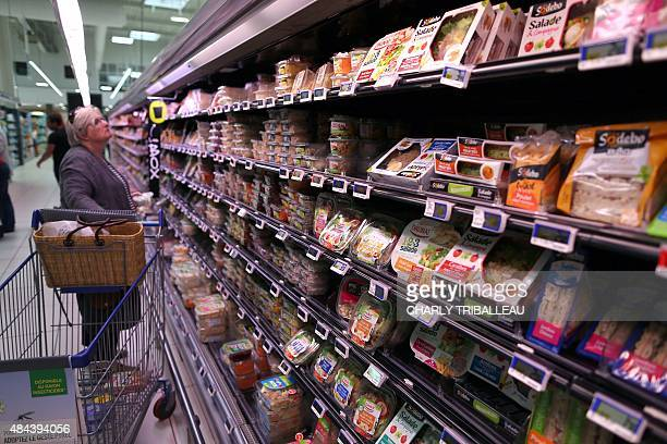 A consumer peruses shelf at a supermarket on August 18 2015 in Coutances northwestern France AFP PHOTO/CHARLY TRIBALLEAU
