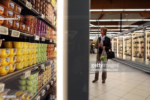 A Consumer peruseS the fridge shelves at a supermarket on August 18 2015 in Coutances northwestern France AFP PHOTO/CHARLY TRIBALLEAU