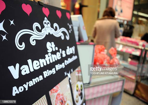 A consumer purchases a St Valentine's Day present at a department store in the Ginza district in Tokyo on February 14 2012 Valentine's Day is a...