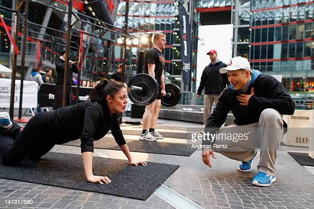 A consumer takes part in a workout during the Reebok Crossfit campaign launch of 'The Sport of Fitness Has Arrived' at Potsdamer Platz on March 14 in...