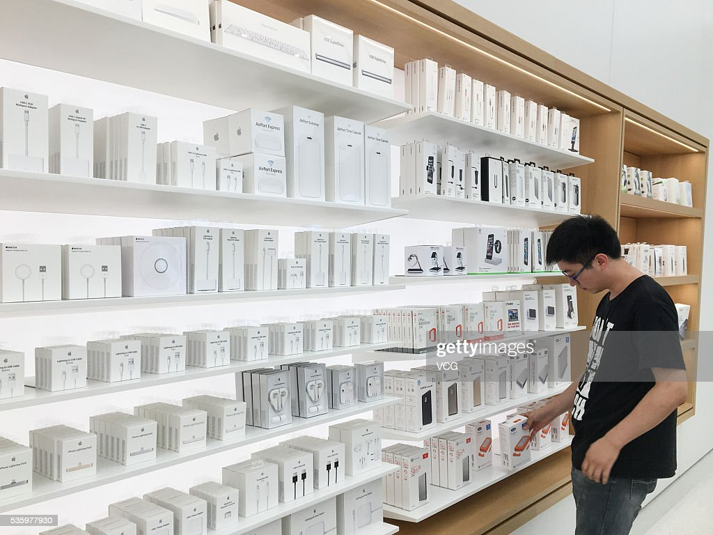A consumer views mobile phone accessories at an new-opened Apple Store in Global Harbor on May 31, 2016 in Shanghai, China. The fifth Apple Store in Shanghai and also the eastern China's first new decoration one opened in Shanghai Global Harbor on Tuesday that consumers can experience Apple Store 2.0 elements like mobile phone accessories, interactive games and audition service. The new Apple Store has marked to be the 38th one In China.