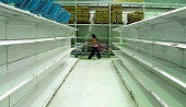 A consumer walks around empty shelves due to the lack of foreign currency cause lack of imported stuffs at a staterun super market on December 18...