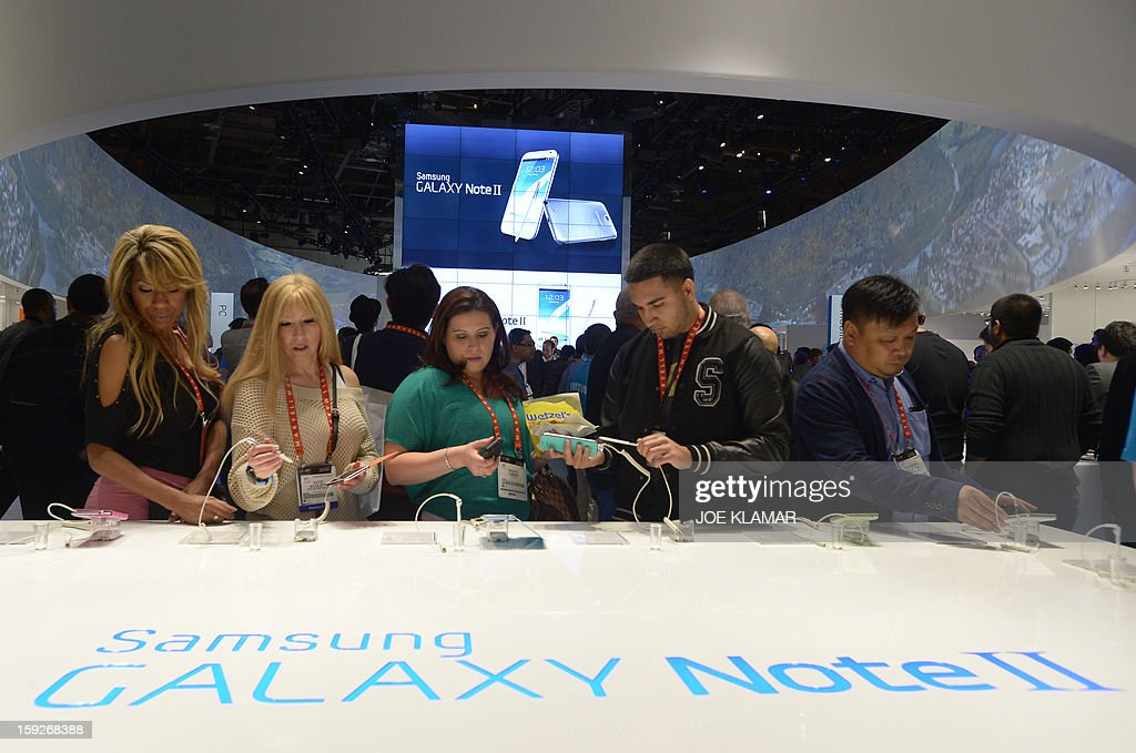 Consumers check products at Samsung booth at the 2013 International CES at the Las Vegas Convention Center on January 10, 2013 in Las Vegas, Nevada. CES, the world's largest annual consumer technology trade show, runs from January 8-11 and is expected to feature 3,100 exhibitors showing off their latest products and services to about 150,000 attendees.
