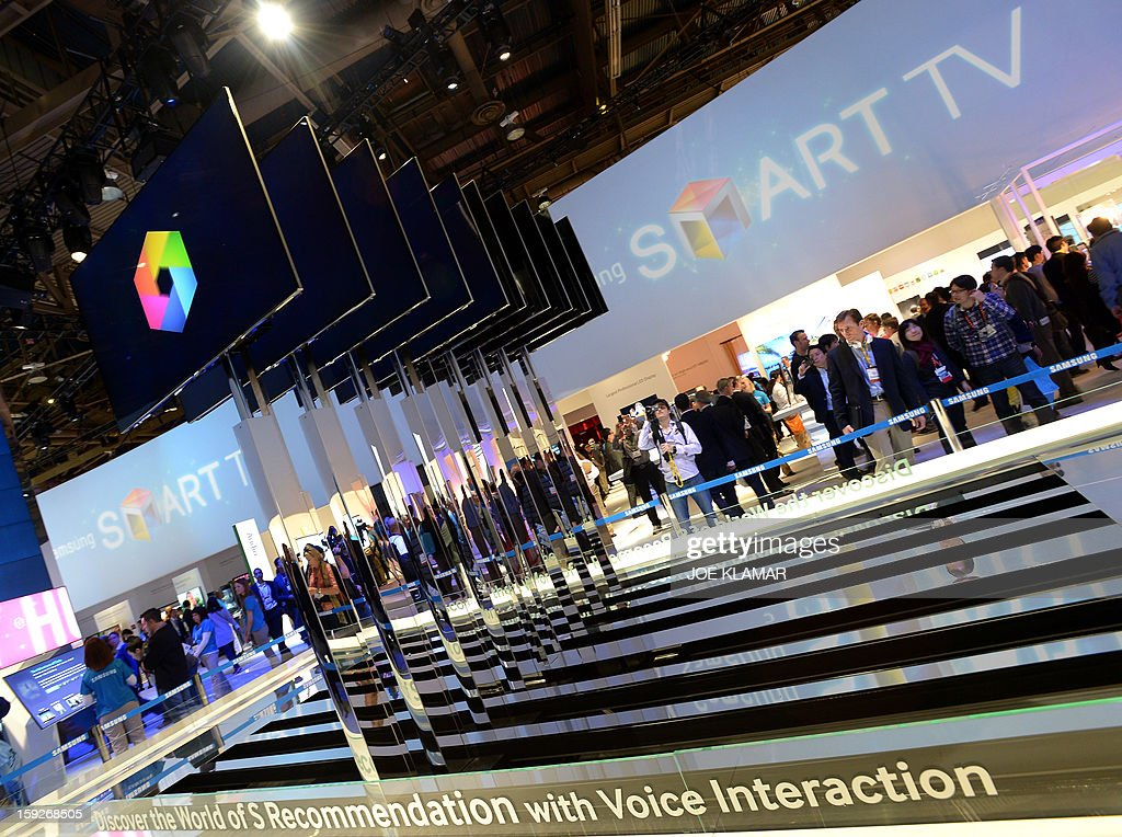 Consumers check products at Samsung booth at the 2013 International CES at the Las Vegas Convention Center on January 10, 2013 in Las Vegas, Nevada. CES, the world's largest annual consumer technology trade show, runs from January 8-11 and is expected to feature 3,100 exhibitors showing off their latest products and services to about 150,000 attendees.AFP PHOTO / JOE KLAMAR