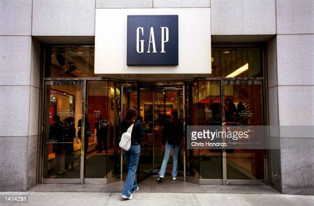 Consumers enter a Gap clothing store in New York City April 12 2000