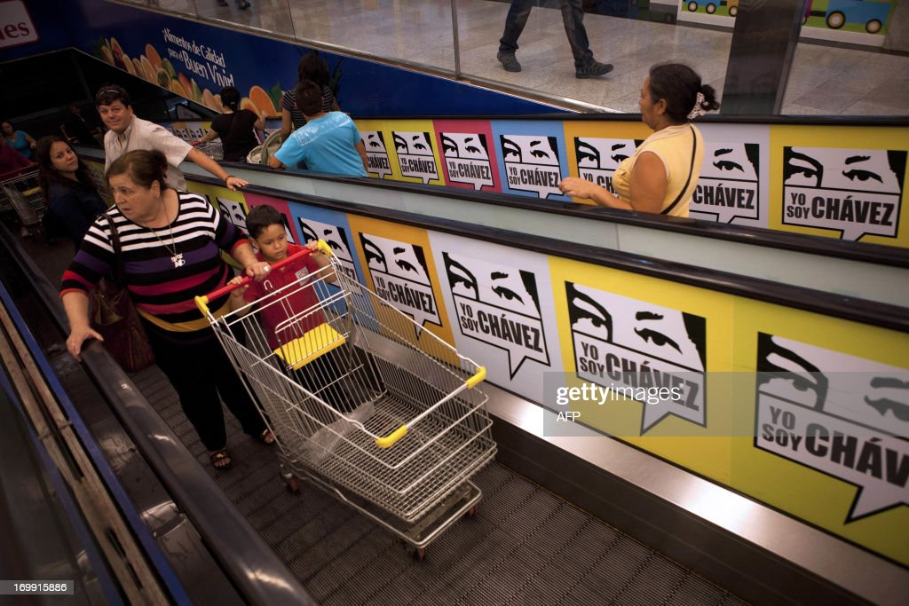 Consumers enter the state-owned Bicentenario supermarket in Caracas, on June 4, 2013. For almost a month there has been a shortage around the country of toilet paper due to a drop in its production and imports. AFP PHOTO/Leo RAMIREZ