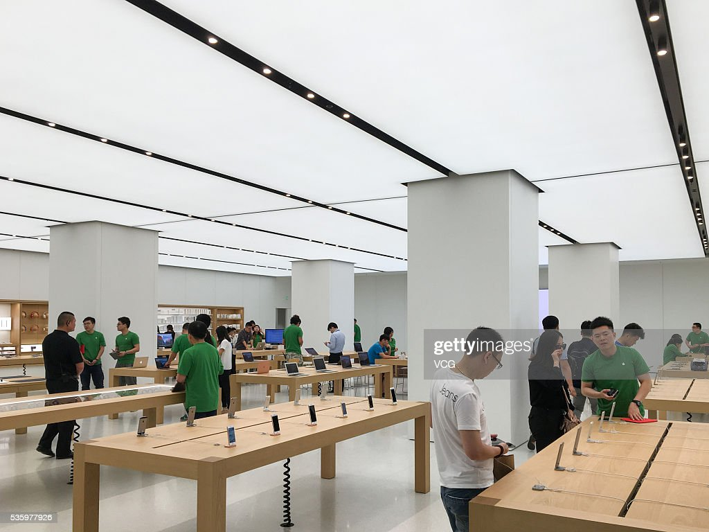 Consumers experience Apple products at an new-opened Apple Store in Global Harbor on May 31, 2016 in Shanghai, China. The fifth Apple Store in Shanghai and also the eastern China's first new decoration one opened in Shanghai Global Harbor on Tuesday that consumers can experience Apple Store 2.0 elements like mobile phone accessories, interactive games and audition service. The new Apple Store has marked to be the 38th one In China.