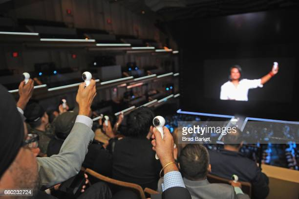Consumers hold up the new Samsung Gear 360 Camera as Samsung Director of Product Marketing Suzanne De Silva speaks during Samsung Unpacked at David...