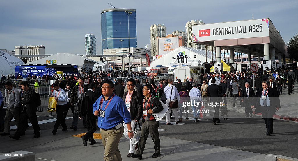 Consumers move between exhibition halls at the 2013 International CES at the Las Vegas Convention Center on January 9, 2013 in Las Vegas, Nevada. CES, the world's largest annual consumer technology trade show, runs from January 8-11 and is expected to feature 3,100 exhibitors showing off their latest products and services to about 150,000 attendees.AFP PHOTO / JOE KLAMAR