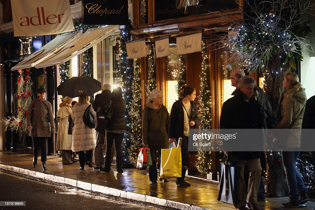 Consumers peruse the shops on Bond Street on November 26, 2012 in London, England. Many prominent retailers in the capital have produced elaborate festive window displays to entice Christmas shoppers with less than one calendar month remaining before Christmas Day.