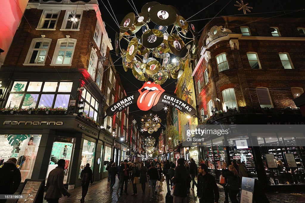 Consumers peruse the shops on Carnaby Street on November 26, 2012 in London, England. Many prominent retailers in the capital have produced elaborate festive window displays to entice Christmas shoppers with less than one calendar month remaining before Christmas Day.
