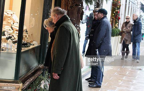 Consumers peruse the shops on New Bond Street on the penultimate Saturday before Christmas Day on December 17 2011 in London England Retail analysts...