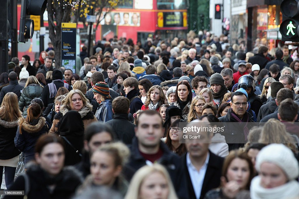 Consumers peruse the shops on Oxford Street on the penultimate Saturday before Christmas Day on December 17 2011 in London England Retail analysts...
