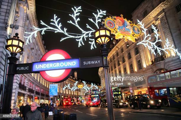 Consumers peruse the shops on Regent Street under the Christmas lights on December 3 2013 in London England