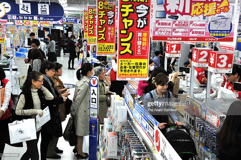 Consumers purchase home electronics goods ahead of the consumption tax hike at Bic Camera Ikebukuro branch on March 18, 2014 in Tokyo, Japan. Japan raises consumption tax from 5 to 8 percent on April 1, and possibly to 10 percent in October 2015, despite market concerns about a slowing of the economic recovery.
