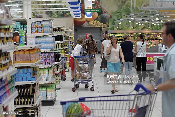 Consumers push trollies around a supermarket on August 18 2015 in Coutances northwestern France AFP PHOTO/CHARLY TRIBALLEAU