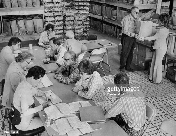 Consumers Quizzed In Post Survey Interviewers quiz Denver residents participating in the 1974 Denver Post Consumer Analysis Survey at survey...