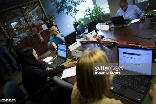 Consumers shop online during a shop and lunch event in the boardroom of the National Retail Federation November 27 2006 in Washington DC The National...