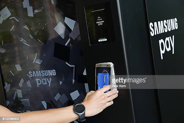 Consumers use the mobile payment service Samsung Pay at the Samsung Pay vending machine at South Congress Hotel on September 24 2016 in Austin Texas