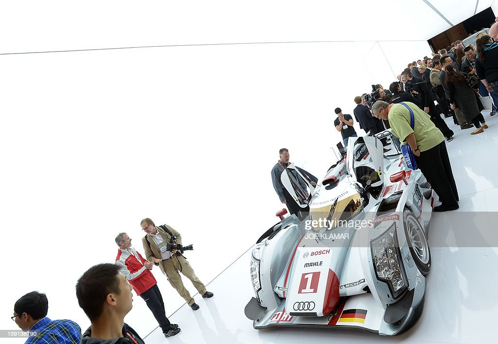Consumers view the Audi R18 e-tron quattro hybrid racing car and first hybrid to win the LeMans race in 2012, at the 2013 International CES at the Las Vegas Convention Center on January 8, 2013 in Las Vegas, Nevada. CES, the world's largest annual consumer technology trade show, runs from January 8-11 and is expected to feature 3,100 exhibitors showing off their latest products and services to about 150,000 attendees.AFP PHOTO / JOE KLAMAR