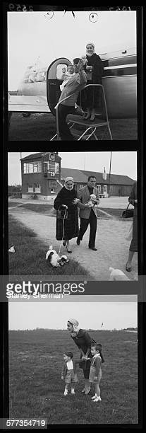 A contact strip depicting Britishborn American actress Elizabeth Taylor at an airfield with her third husband American producer Mike Todd and her...