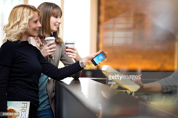 Contactless payment  with mobile phone at the coffee bar