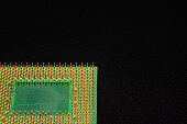The processor for a personal computer has many pins for connecting to devices on the motherboard. Gold plated contacts