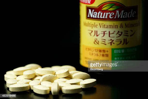 A container and tablets of Nature Made 'Multiple Vitamin Minerals' supplement imported by Otsuka Pharmaceutical Co are arranged for a photograph in...