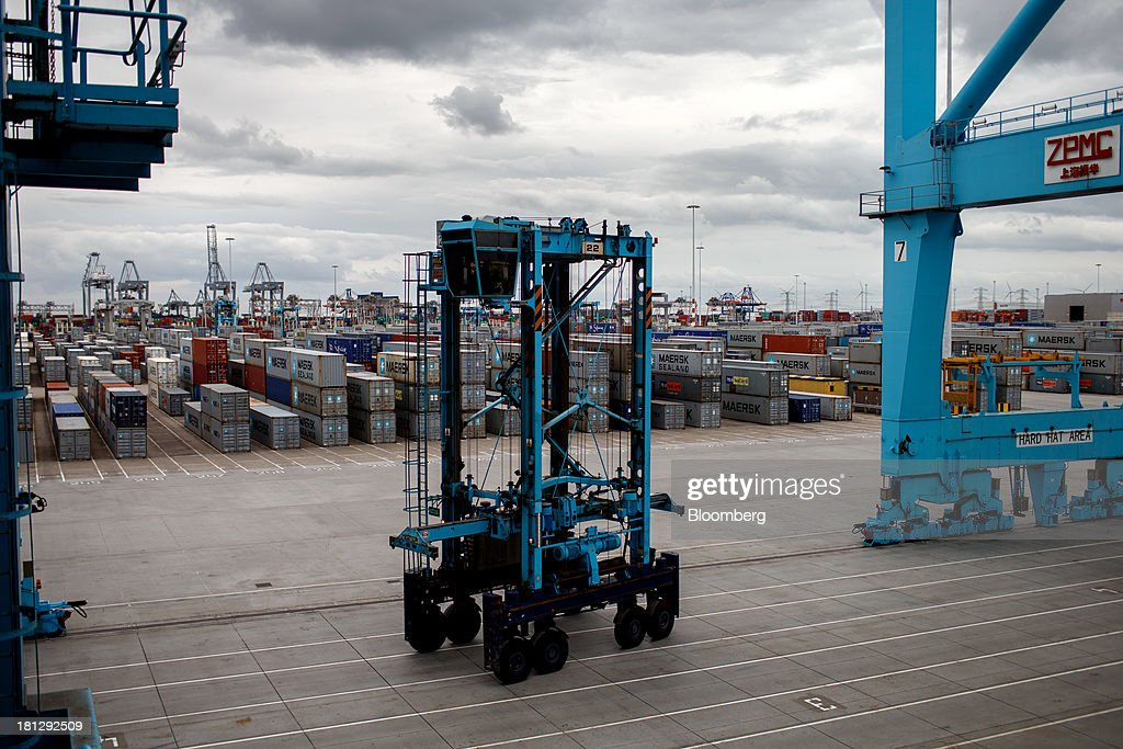A container crane passes along the dockside as shipping containers sit at the APM Terminal, operated by AP Moeller-Maersk A/S, in the Port of Rotterdam, in Rotterdam, Netherlands, on Thursday, Sept. 19, 2013. The pace of economic contraction in the Netherlands, which is in its third recession in five years, is slowing. Photographer: Jasper Juinen/Bloomberg via Getty Images