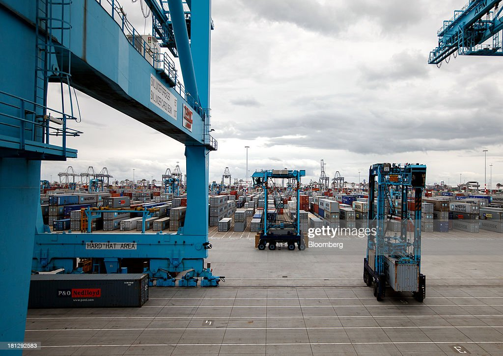 Container cranes pass along the dockside as shipping containers sit at the APM Terminal, operated by AP Moeller-Maersk A/S, in the Port of Rotterdam, in Rotterdam, Netherlands, on Thursday, Sept. 19, 2013. The pace of economic contraction in the Netherlands, which is in its third recession in five years, is slowing. Photographer: Jasper Juinen/Bloomberg via Getty Images