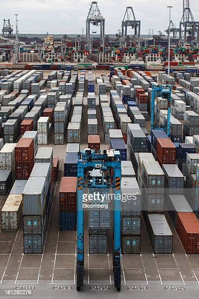 Container cranes transport cargo at the APM Terminal operated by AP MoellerMaersk A/S in the Port of Rotterdam in Rotterdam Netherlands on Thursday...