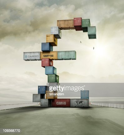 container currency pound on sunny cargo ship deck : Stock Photo