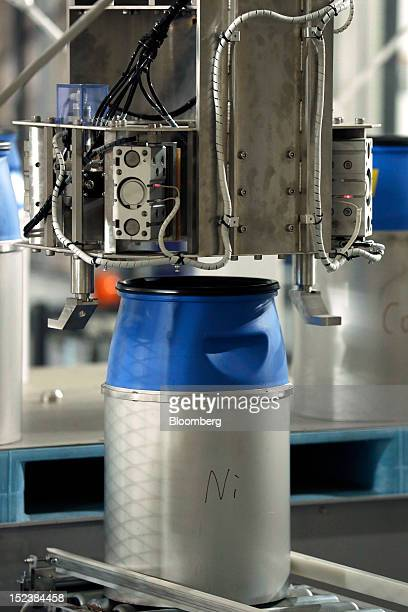 A container filled with raw material moves along the production line at the JX Nippon Mining Metals Corp plant for making cathode materials used in...