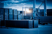 container freight station against sunbeam,blue toned image.