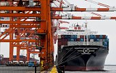 A container freighter anchours at a pier in Tokyo on July 25 2016 Japan on July 25 posted its first halfyear trade surplus since the 2011 Fukushima...