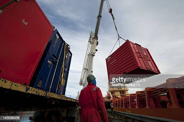 A container is loaded on a lorry at the Falkland Islands harbor on March 28 2012 April 2 2012 commemorates the 30th anniversary of the war between...