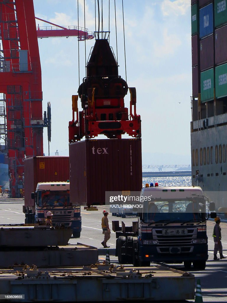 A container is loaded onto a cargo ship at a container wharf in Tokyo port on October 8, 2013. Japan's current account surplus was a sharply lower-than-expected 161.5 billion yen ($1.67 billion) in August.